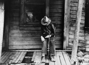 Old Man Sleeping on Porch